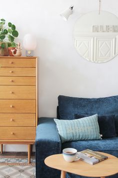 Hello Blogzine's stunning blue velvet sofa   mirrors are the best way to add light and a sensation of space to any room   IKEA Kivik sofa with a Bemz sea blue velvet cover   Retro coffee table and cabinet