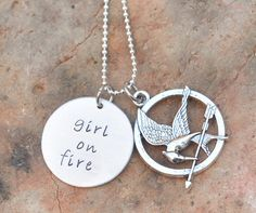 Hunger Gams Inspired hand stamped necklace - Girl on fire - mocking jay - katniss. $20.00, via Etsy.