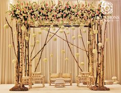 Birchwood branches with hanging floral balls, and a border of soft, pastel floral is the perfect combination of elegance and nature. Event Decorators : Occasions By Shangri-la Wedding Ceremony Ideas, Indian Wedding Receptions, Rustic Wedding Backdrops, Wedding Stage Decorations, Engagement Decorations, Wedding Mandap, Wedding Themes, Marriage Decoration, Wedding Dinner