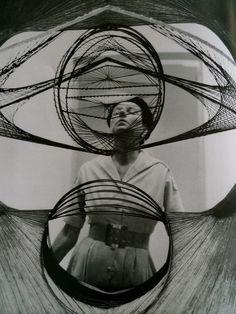 Peggy Guggenheim seem through a Pevsner sculpture.