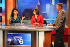 Doc discusses the weather on set with KHOU 11 News Anchors Shern-Min Chow and Lisa Hernandez.