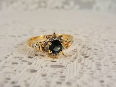 1980's Blue Sapphire Wrapped with White Rhinestones Gold Tone Ring – Size 7 by CarolsVintageJewelry on Etsy