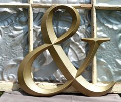 Ampersand/ Gold Ampersand/ Large Ampersand/ Wedding Sign/ AND Symbol Sign/ Custom Painted Family Initials/ Wedding Photo Booth Prop. $23.95, via Etsy.