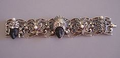 """PAM oriental face 7-1/4"""" bracelet set in silver tone.  morning glory antiques"""