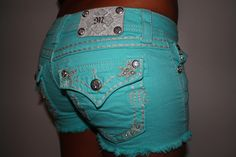 turquoise miss me shorts.