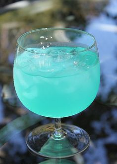 Sea glass cocktail! Lemonade, lemon vodka, blue curacao and lime juice.