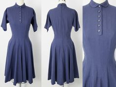 1950s dress by designer Anne Fogarty. Fitted bodice with 6 functioning buttons at front. Small Peter Pan collar with hook and eye underneath. Close cut dolman sleeves. Wide sweeping skirt with drop waist and pockets in each side seam. Back metal talon zip with two hooks and eyes at neck. Interior ribbon with hook and eye at waist. Pinked seams. 1 to let down at hem. Most likely wool. Excellent condition.  Model wearing crinoline, not included.  Best fits a modern size 2/4/6  Measu...