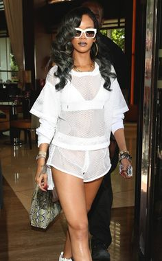 Leaving her hotel in London, Rihanna flaunts her new gray 'do and her killer bod. Just another day in the life of RiRi. #style