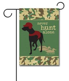 "Never Hunt Alone Camo - Garden Flag - 12.5"" x 18""  Flag stand sold separately  Proudly Printed in the USA  Vibrant colors printed on a poly/cotton outdoor quality fabric.  Digitally printed on both sides of the fabric. Text is reversed on the back of flag.  Ships in 5 days or less!"