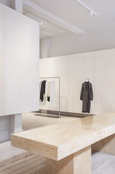 Studio David Thulstrup designs minimalist boutique for Mark Kenly Domino Tan Grey Painted Walls, Neutral Walls, Showroom Design, Interior Design, Interior Architecture, Stone Island Store, Metal Clothes Rack, Daybed Covers, Glass Brick