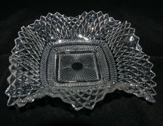 Vintage depression era clear glass candy dish with ruffled edges in the diamond cut design. I started with one of these that was my mom's and now I collect them and use them as berry bowls, nut dishes and candle holders. SO pretty with lots of silver and candlelight.