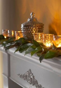 """""""A row of tea light candles nestled among greenery provides a twinkling glow, perfect for subtle mantel décor. Embellished votives and silver accent pieces lend some extra sparkle."""" """"Decorating Holiday Mantels,"""" Traditional Home. All Things Christmas, Winter Christmas, Christmas Home, Merry Christmas, Christmas Ideas, Royal Christmas, Tartan Christmas, French Christmas, Christmas Planning"""