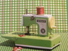 Vintage green childrens Sewmate Sewing Machine.