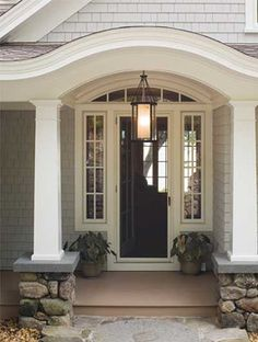 Gracious entryway with eyebrow detail and hanging fixture.