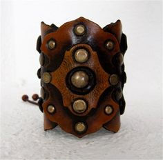 Studded leather cuff by Karen Kell.
