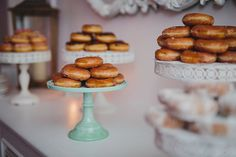 This Southern wedding's sweets table wasn't just limited to tradtional wedding desserts. The bride and groom made sure to include tasty donuts stacked on tiered plates! | Anelise & Adam's Pretty St. Augustine, FL Real Wedding by Stephanie W. Photography
