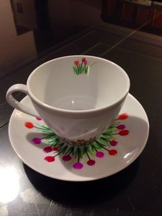 Tulip design on a cup...used sharpies to design a blank cup and saucer. So much fun!!!