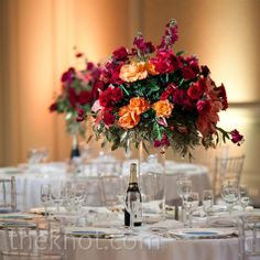 I'm thinking silk bouquets of cream and peach roses on different tables as the centerpieces