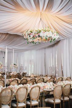 Large Floral Chandelier & Drapery Photography: Kate Osborne Photography Read More: http://www.insideweddings.com/weddings/stylish-destination-wedding-with-gorgeous-blooms-in-sundance-utah/1008/
