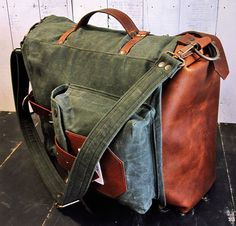 The Nomad Backpack II is a hand waxed canvas and leather roll top bag. Expandible, water resistant, ideal for school, work, commute, travel or camping. If you were looking for the ideal pack that can keep up with you with all your activities, Nomad is your choice. Its expandable