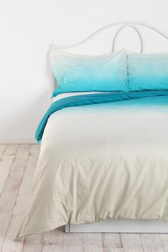 This bed set makes me want to float up toward the pillows.  As if beds aren't glorious enough. :)  UO Magical Thinking Gradient Duvet Cover $89