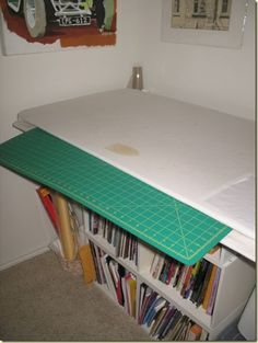 Smart idea for dual duty of small space. Ironing board/cutting table.