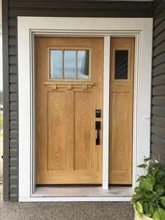 Our front door. Fibreglass door with wood stain. Expensive look for a fraction of the cost!