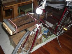 $2 wooden front bike rack with integrated LED light (flashlight).