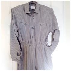 """VINTAGE suiting jumpsuit - classy 80s!! Vintage '80s grey jumpsuit with red pinstripes - slightly oversized men's suiting styling, hip pockets, button front & zip fly, stretch high waist, crisp pleats/creases, shoulder pads, poly/rayon blend. In fantastic condition, but missing original belt. Measurements: waist flat across 14""""/16.5"""" stretched, 28.25"""" inseam, 20.25"""" pit to cuff, 19"""" flat across pit to pit, 13"""" rise (high waist!), 8.75"""" ankle, 12.75"""" widest part of thigh (flat across). Marked…"""