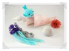 The Precious Pom Pom Sea Creatures Craft is too cute for words. I'm loving on these and other fish crafts for kids! Here's a GREAT list of Wonderful craft to accompany the book Who Made You. Fish Crafts Kids, Beach Crafts For Kids, Sea Crafts, Animal Crafts For Kids, Easter Crafts For Kids, Craft Activities For Kids, Summer Crafts, Craft Stick Crafts, Book Crafts