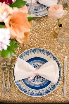 Glittering tablecloths + bow-shaped napkins = wedding reception decor perfection.