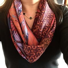 Two scarves, complimentary colors.