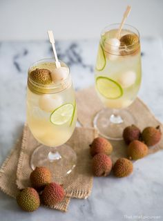 Lychee Sangria: 750 mL bottle Sauvignon Blanc 1/2 cup St. Germain Elderflower Liqueur 20 oz canned lychee in heavy syrup, drain but reserve syrup 3/4 cup reserved lychee syrup 2 limes, sliced thin fresh lychee, to garnish