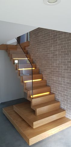 Modern zig zag staircase with LED, made by Siller Stairs