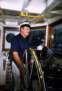 "John Wayne on his yacht, ""Wild Goose,"" 1971.© 1978 David Sutton"