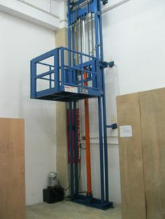 Two posts cargo lift is used for lifting material from one level to another with good safety and efficiency. http://www.mornlift.com/vertical-lift/lead-rail-lift.html