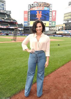 Knock out! The Confident singer showcased her svelte figure in high-waisted jeans and a low-cut blouse
