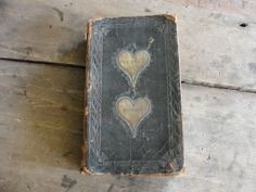 """Antique """"Leather"""" bound book with """"Hearts"""" on the cover!!!"""