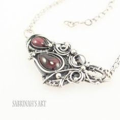 """""""Interconnection"""" Garnet and Fine and Sterling Silver Wire Wrapped Necklace"""