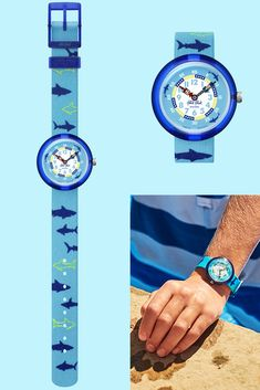 SHARKASM (ZFBNP157) makes a bold statement thanks to its printed textile strap that features sharks swimming in the deep blue sea. Shock and water resistant for complete peace of mind, this is an ideal gift for younger children - learning the time with this kids' watch in blue will be a crazy adventure! Shark Swimming, Deep Blue Sea, Sharks, Kids Learning, Swatch, Peace, Adventure, Printed, Children