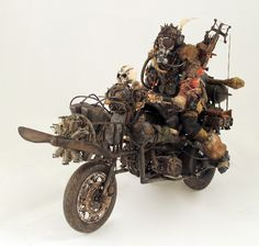 wanderer vehicle. converted motorcycle. wanderer with crossbow. airplane propeller. Bassmen. post appocalyptic biker