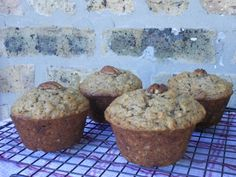 Peanut-Butter Banana Muffins - For a hearty breakfast-on-the-go or a healthy snack, whip up a batch of these lightly-sweetened, moist muffins using old-fashioned rolled oats, vibrant golden applesauce, a sprinkle of cinnamon, and the lip-smacking addition of peanut butter and banana. In a hurry? These muffins make for an excellent breakfast-on-the-go!