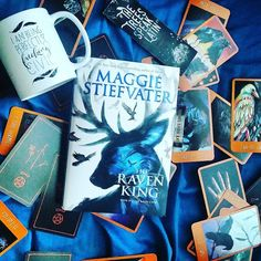I own a lot of Raven Cycle merchandise. I'm about halfway through The Raven King and I am LOVING it.  #books #book #YA #bookstagram #bookstagramfeature #bookishfeatures #featuringbooks #TheRavenKing #theravencycle #maggiestiefvater #bibliophile #igreads #tarotcards #tarot #bookandmug by alekas_rodrique