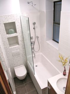 This tight space utilized a half wall of glass instead of a enclosed door or shower curtain- thus making the space feel open