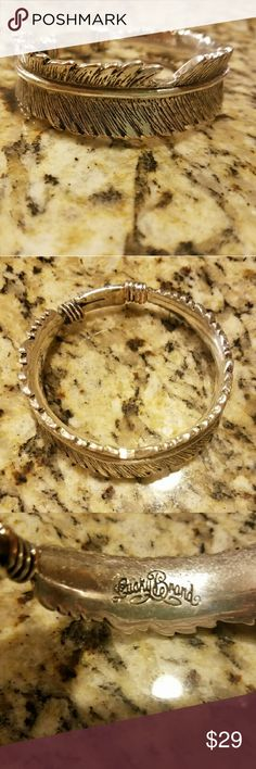 Lucky Brand Bangle/Bracelet Lucky Brand. Bangle style bracelet. Feather design.  2 3/4 inch opening. Silver metal color. Lucky Brand Jewelry Bracelets