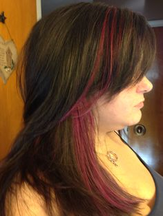 Pink and purple peek a boo hi lights with razored cut and layers hair