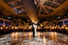 """Our first dance was to the Goo Goo Dolls' """"Iris,"""" our favorite song from when we started dating in high school. The dance floor was designed to look like a mosaic courtyard and was my favorite decor element in the room."""