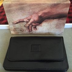 "Genuine Italian Leather Wallet NWOT Genuine Black Leather Wallet NWOT. In Original Box. 7"" l X 4"" H. Never used. Stored for years! Back has zipper change purse. Inside center zipper for money or credit cards. Please ask all questions prior to buying! I bundle Bags Wallets"