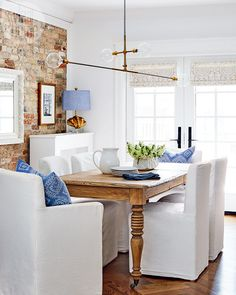 This dining room is open to the kitchen so it had to be casual, while the patterns on the blinds and toss cushions reference those in the rest of the home for continuity.
