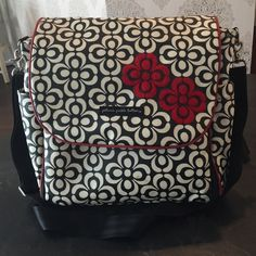 Petunia pickle bottom Boxy backpack The most versatile high quality diaper bag! This boxy backpack is a coated fabric with a black/white print with red accents. Features detachable shoulder strap that can adjust to wear cross body and 2 detachable straps that turns the bag into a backpack. Zip down detachable changing pad with original wipe holder. Tons of pockets both inside and out. Great pre owned condition. Slight discoloration where the straps have been laying on the bag. See the last…